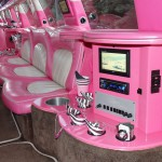 Johnny B's Pink Limo interior photo with pink balloons for a pink limo party