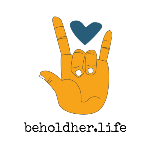 beholdher.life heart with hand logo self-care -mind-body-spirit