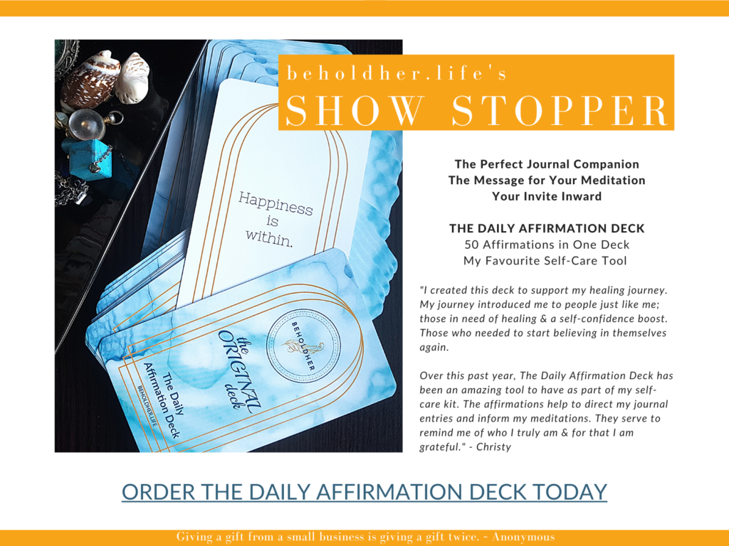 beholdher.life's Show Stopper The Daily Affirmation Deck - 50 Affirmations in One Deck and My Favourite Self-Care Tool. Photo of the deck with an example of an affirmations. Link to order the deck today.