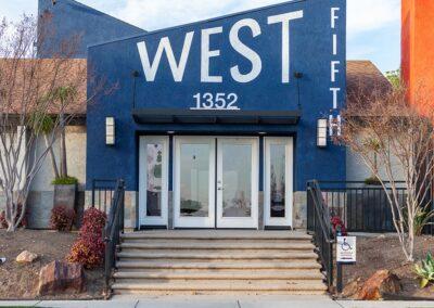 Entrance West Fifth blue apartment building