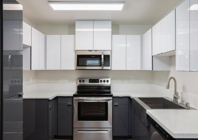 Kitchen with white countertops and cabinets and stainless steel appliances