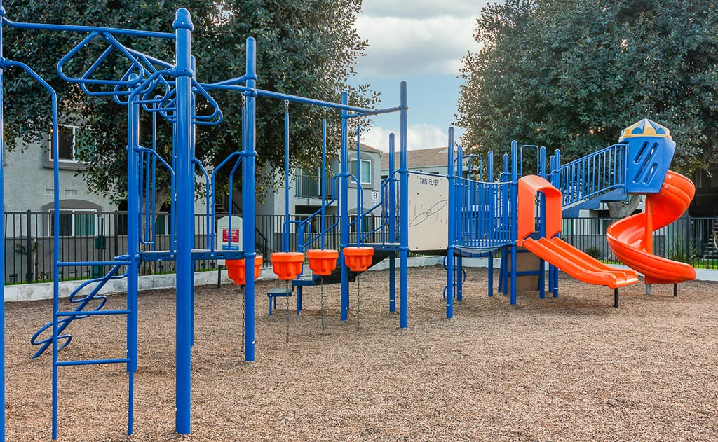 Playground area with blue and orange equipment