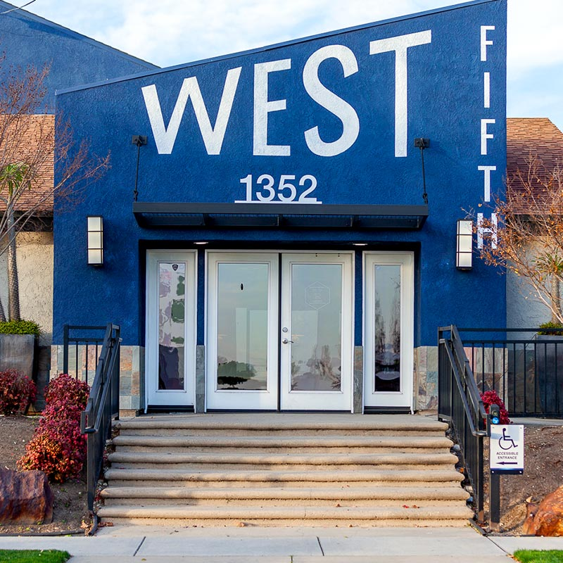 Entrance West Fifth blue apartment building