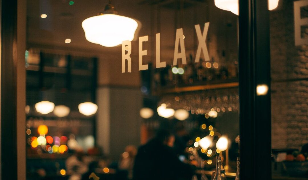 "coffee shop sign that says ""relax"""