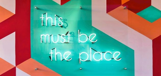 """neon sign that reads """"this must be the place"""""""