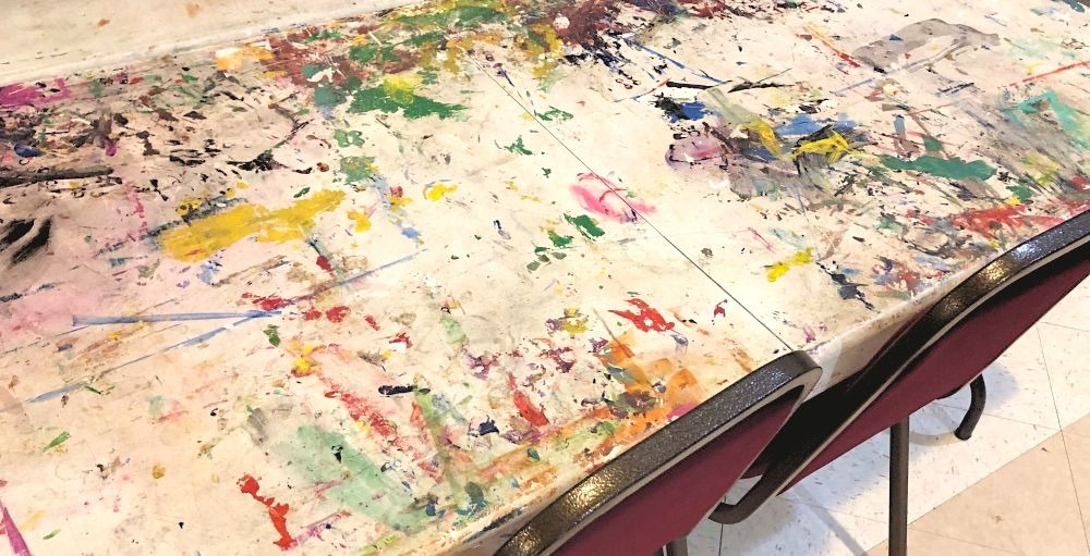 tables with paint splatter