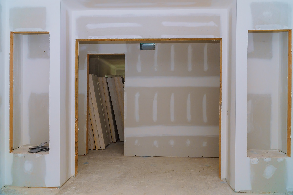 Interior construction of housing project with door and molding installed