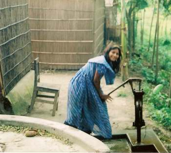 A Young Woman Using a Tube Well in Bangladesh