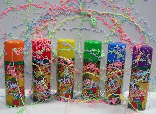 Silly String cans and string flying