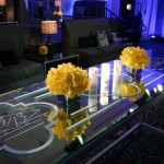 """For a family who appreciates the """"Art of Celebration"""" their son's Bar Mitzvah included all his passions from Rap to Bling! Dubbed the """"13/13 Club,"""" we based the event on Rapper Jay-Z's 40/40 Club in Las Vegas. From """"Bling Boulevard"""" to fabulous VIP décor, hydrogen walls and entertainment including MTV's DJ Skribble and Rapper T.I. the event was pure 21st Century! It was a kid friendly environment that found common ground with their parent's passion to party."""