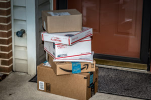packages stacke on front porch