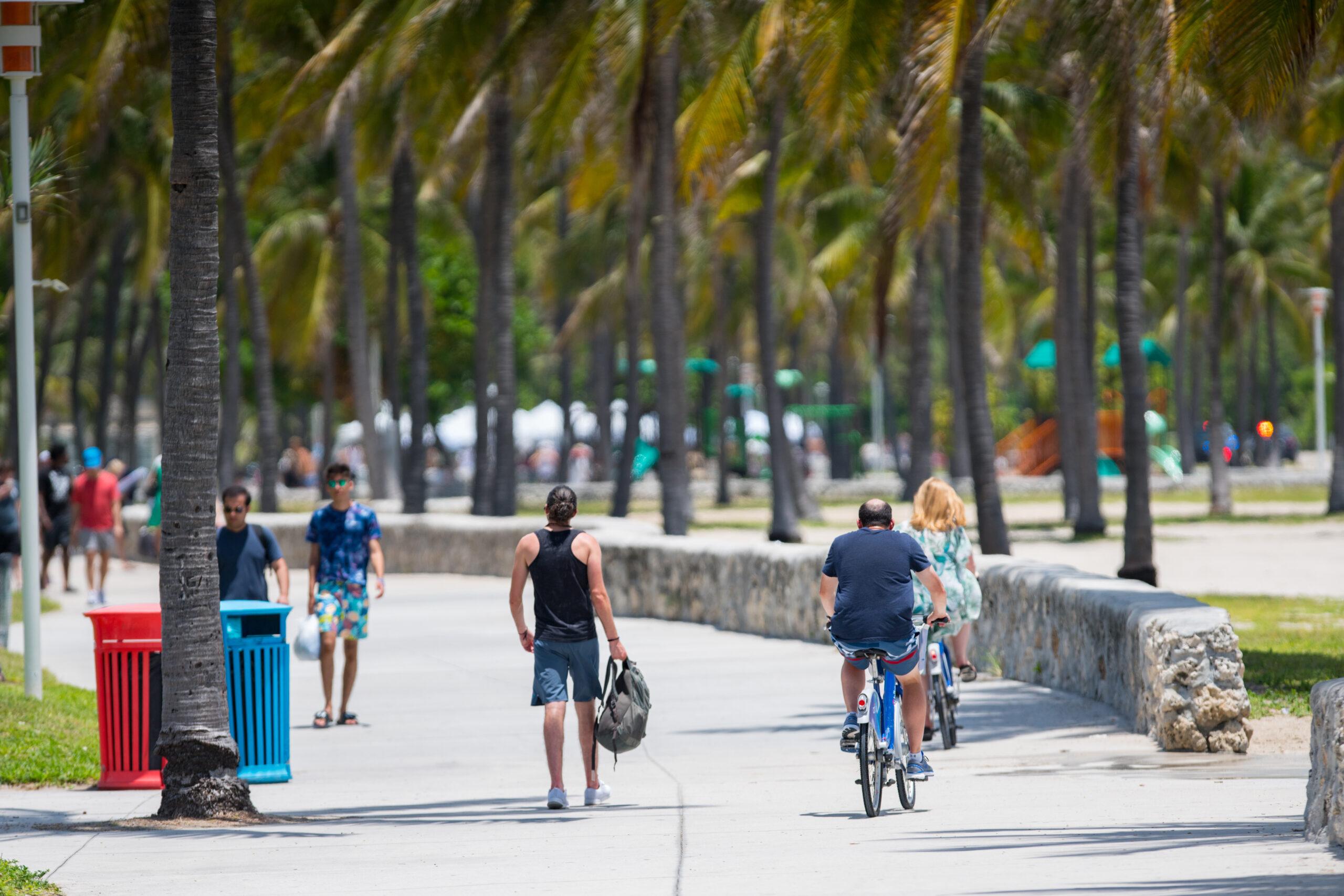 People biking on Ocean Drive Miami Beach FL USA