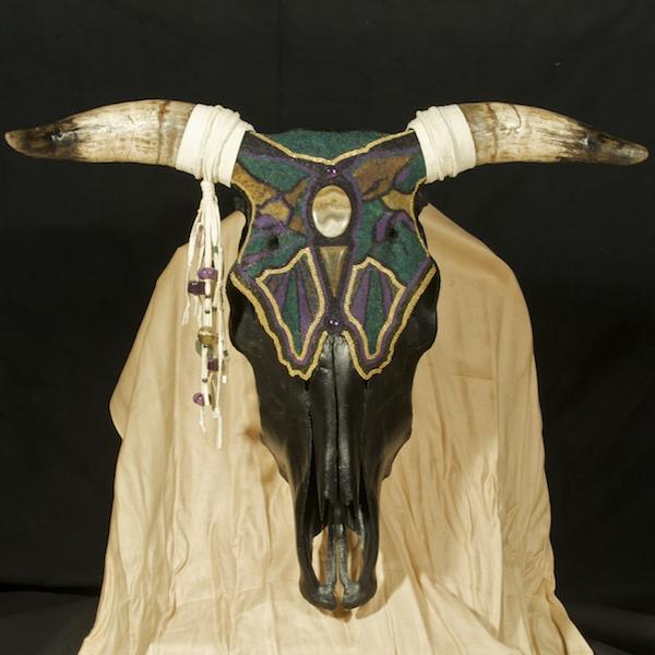Huichol-inspired beaded cow skull