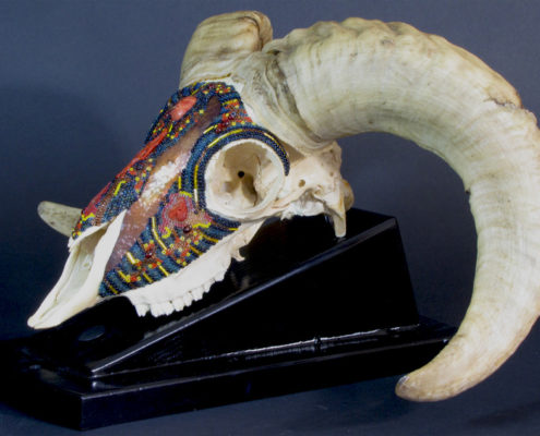 Huichol inspired beaded ram skull