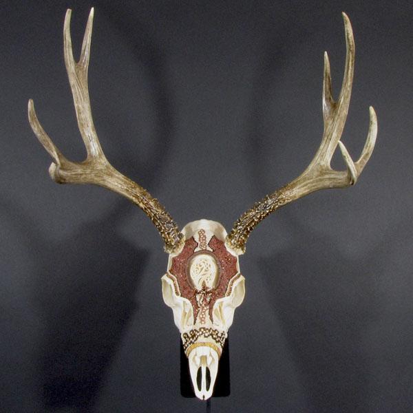 Huichol-inspired beaded mule deer skull