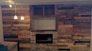 Rustic basement fireplace pallet wall