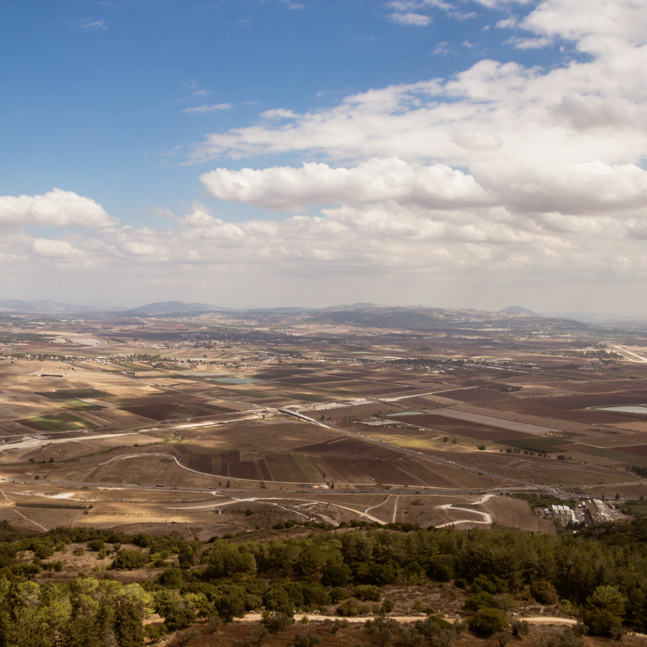 Megido valley, Armageddon battle place with empty fields, cloudy sky, Tel Megido, Israel