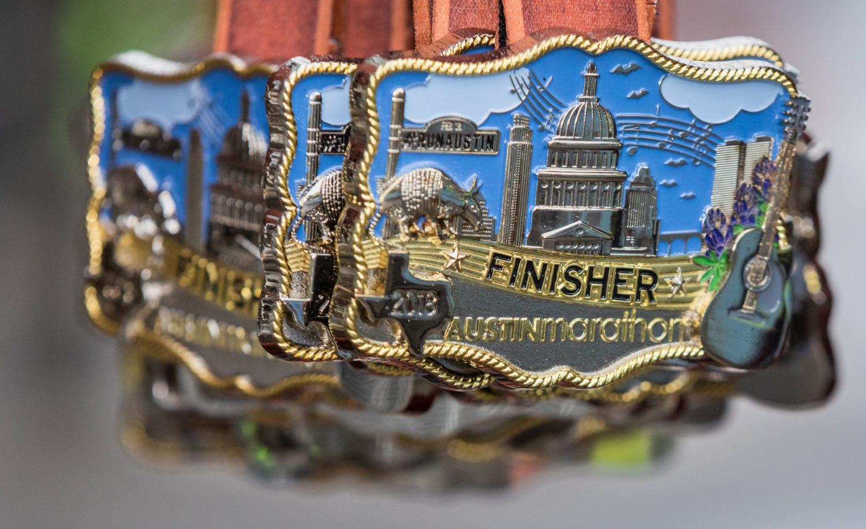 belt buckle finisher medals: perks of the 2019 Austin Marathon