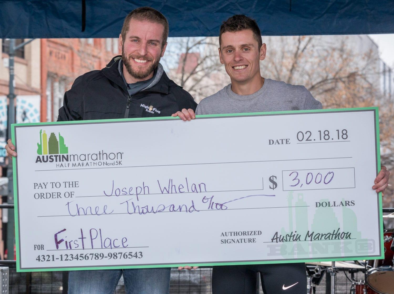 Joey Whelan accepts his Austin Marathon championship check.