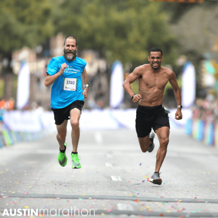 two-people-sprint-to-the-finish-of-the-austin-marathon