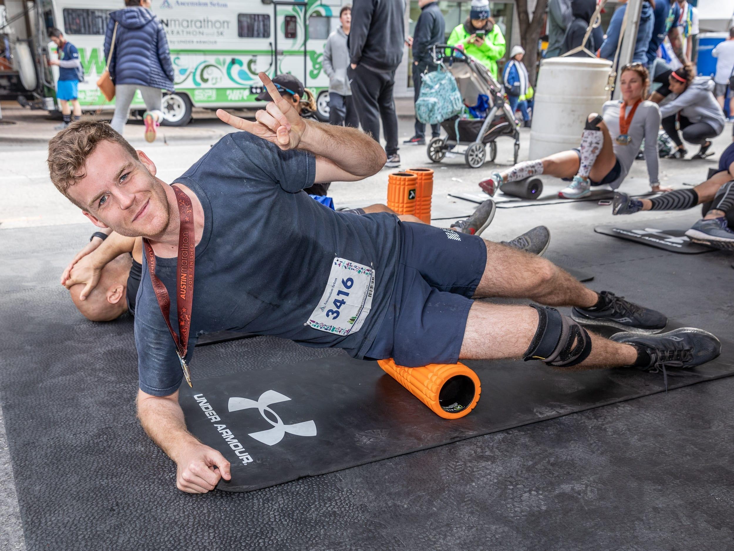 Runner foam rolls after 2019 Austin Marathon, a great tip to see improvement during training!