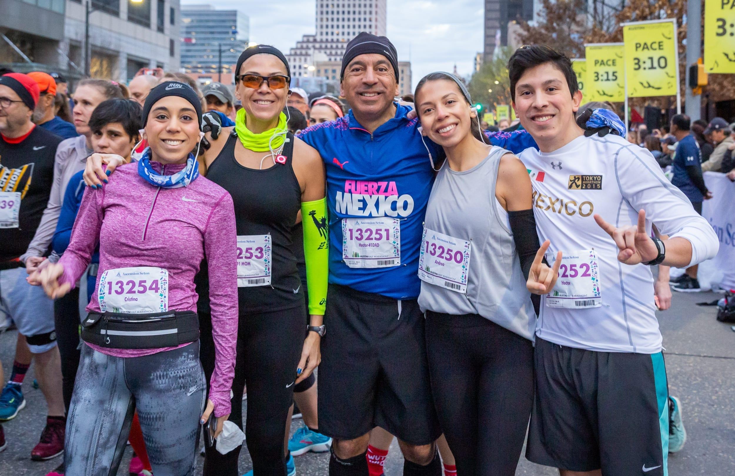 Group photo of friends before running the 2019 Austin Half Marathon. Running with friends is a great beginning running tip.