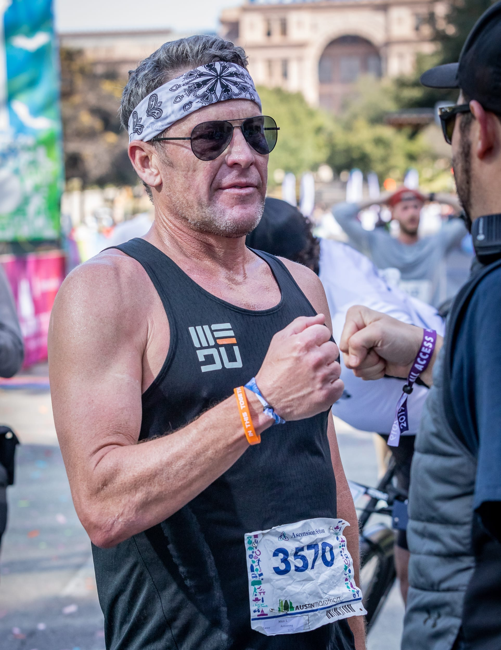 Lance Armstrong, the Austin Gives Miles Charity Chaser, at the 2019 Austin Marathon finish line. Running on behalf of Austin Gives Miles is a great tip to stay motivated.