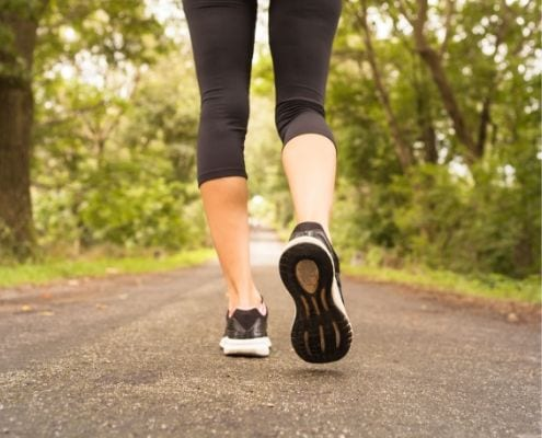 Runner runs on trail, one of nine beginner running tips.