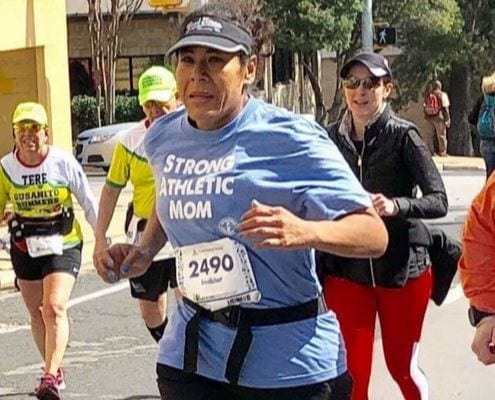Erica Richart running the 2019 Ascension Seton Austin Marathon. She created a better life for herself through running.