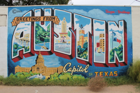 Image of the Greetings from Austin mural. Snap a picture when you visit 2 of the south Austin coffee shops on our list!