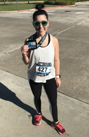 Brittany Drennan poses with a half marathon finisher medal. Read her edition of My Running Story to learn how she's been given the opportunity to run again.
