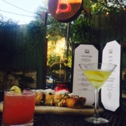 Image of drinks and appetizers at Botticelli's outdoor space in the back. They're one of the Austin Marathon's five recommended south Austin restaurants. Credit: Botticelli's Facebook page.