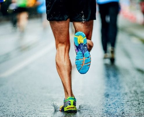 Image of a runner running on the road. Rene Arquello is dedicating his first marathon, the Austin Marathon, to his wife Veronica!