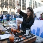Image of a bartender pouring a drink with Tito's Handmade Vodka at the 2019 Austin Marathon Hilton VIP Experience.