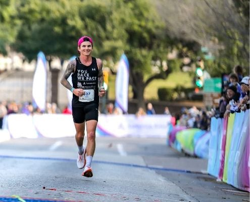 Image of Rory Tunningley crossing the 2019 Austin Marathon finish line as a pacer. Tunningley is included in the fourth round of elite runners accepted to the 2020 Austin Marathon.