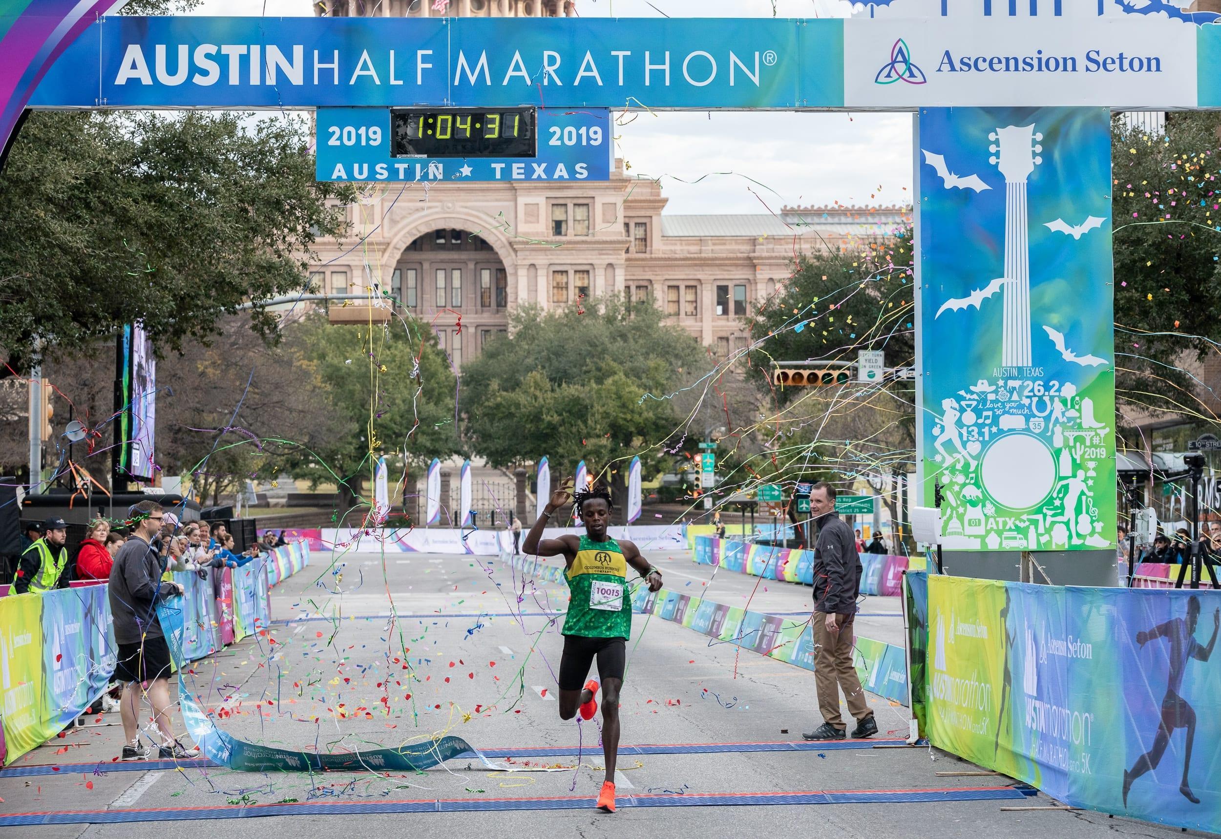 Austin Half Marathon Men Champion Crossing the Finish Line