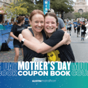 Image of a mother and daughter hugging at the 2020 Austin Half Marathon finish line. Enjoy this blog and download the free Mother's Day coupon book!