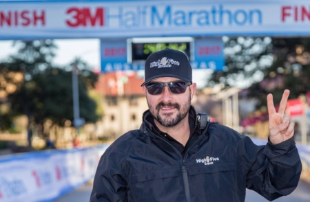 Image of Jack Murray showing the peace sign at the 2017 3M Half Marathon. Read this blog to meet High Five Events.