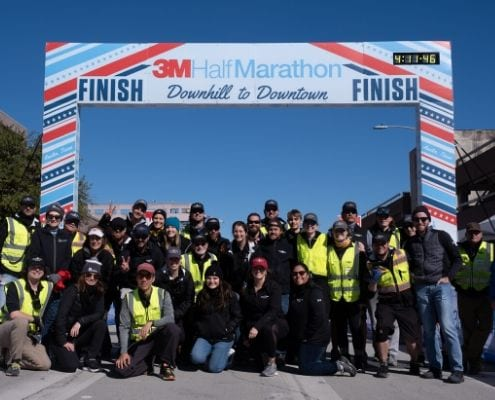 Image of the High Five Events crew after the 2020 3M Half Marathon. Read this blog to meet High Five Events.