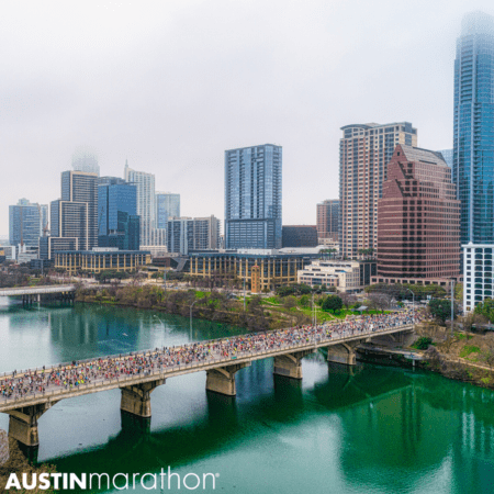 Image of the Austin skyline as runners cross the Congress Avenue Bridge during the 2020 Ascension Seton Austin Marathon. Registration for the 30th annual Austin Marathon opens on June 1st.
