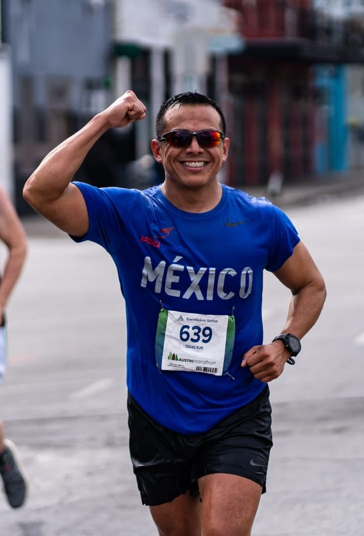Image of runner from Mexico with his right arm flexed during the 2020 Ascension Seton Austin Marathon. This blog post have tips for first-time runners, like how to be relaxed and run your best.
