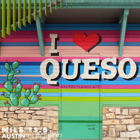 Image of the I Heart Queso mural in Austin. It's one of the Austin Marathon's favorite on-course murals.