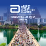 Drone image of runners crossing Congress Avenue Bridge during the 2020 Ascension Seton Austin Marathon with the Austin skyline in the background. The design contains the Abbott World Marathon Majors logo and text that introduces the Austin Marathon as an official AbbottWMM Wanda Age Group World Rankings qualifier.