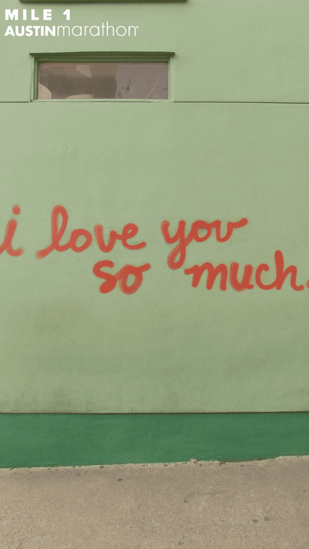 Image of i love you so much mural in Austin. It's one of the Austin Marathon's favorite on-course murals and sized for Instagram Stories so users can upload the image and take a selfie with the mural using Instagram's green screen effect.