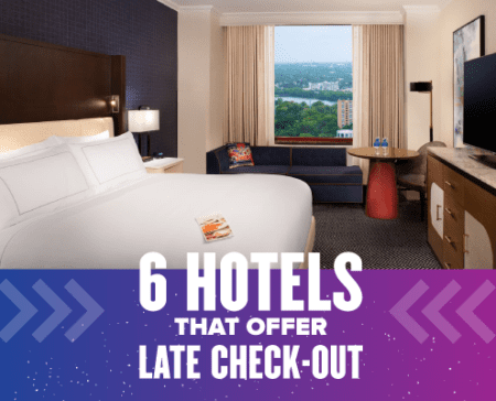 Image of the inside of an Austin hotel room with the window overlooking Town Lake. Text of the design reads 6 hotels that offer late check-out. Corresponding blog lists 6 hotels that offer late check-out for 2021 Austin Marathon weekend.