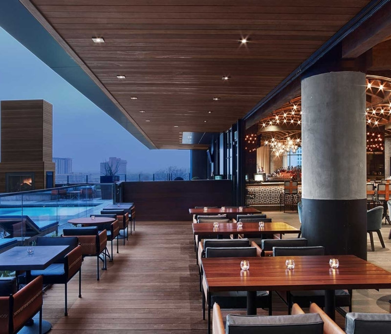 Image of Hotel Van Zandt bar overlooking the rooftop pool, credit Hotel Van Zandt. Book a luxury hotel and make your Austin Marathon weekend that much more memorable. More information at https://youraustinmarathon.com/austin-luxury-hotels/