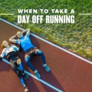 Male and female runner lay on the track after a workout. Text on design reads When to Take a Day Off Running. Read more at https://youraustinmarathon.com/take-a-day-off/