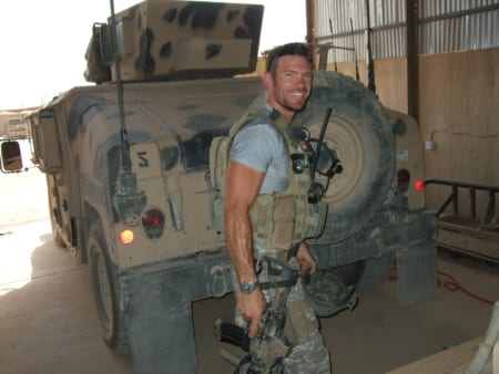 Nate Boyer smiles for the camera in front of a Humvee while serving as a Green Beret. Image courtesy of Nate Boyer.