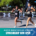 Two women excitedly run towards the finish of the Austin Marathon.