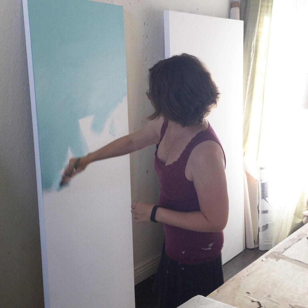 artist-allison-cosmos-painting-in-studio